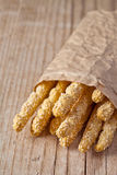 Bread sticks grissini with sesame seeds Royalty Free Stock Images