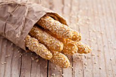 Bread sticks grissini with sesame seeds in craft pack Royalty Free Stock Photo
