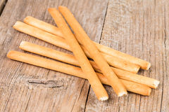 Bread sticks grissini on wooden background Stock Photo