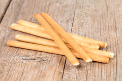 Bread sticks grissini on wooden background Royalty Free Stock Photos
