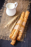 Bread sticks, jug of milk and wheat ears Royalty Free Stock Photography