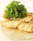 Bread sticks with parsley on a wooden stand. Bread sticks puff testas parsley, sesame seeds and onion Stock Photo