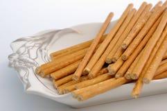 Bread sticks on plate Stock Photo