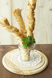 Bread sticks puff testas parsley, sesame seeds and onion. Bread sticks puff pastry with parsley and sesame seeds in a glass Stock Image