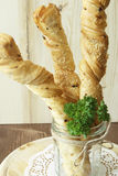 Bread sticks puff testas parsley, sesame seeds and onion. Bread sticks puff pastry with parsley and sesame seeds in a glass Stock Photo