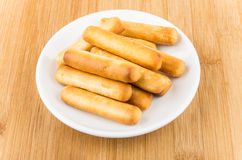Bread sticks with salt in saucer on table Stock Photography