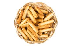 Bread sticks with salt in wicker basket, top view Royalty Free Stock Photos