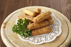 Bread sticks sprinkled with sugar. On a wooden stand Stock Image