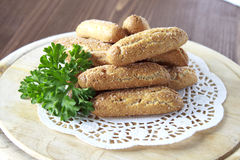 Bread sticks sprinkled with sugar. On a wooden stand Royalty Free Stock Photography