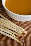 Bread sticks and tomato soup. In a bowl Stock Photo