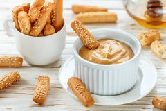 Free Bread Sticks With Sesame Seeds With Mustard And Honey Dip Sauce Royalty Free Stock Image - 137834136