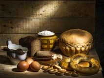Bread. Still life with black, white bread, bagels and drying Royalty Free Stock Photos