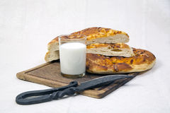 Bread. Still life. food. sliced rye bread with a knife on a tray Stock Photo