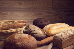Bread in stock on a wooden table royalty free stock images