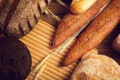 Bread in stock on a wooden table stock images