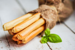 Bread stocks on wooden background Royalty Free Stock Photography