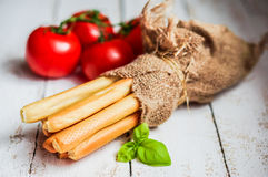 Bread stocks on wooden background Stock Image