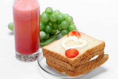 Bread with strawberry jam Stock Images