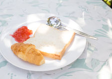 Bread with and strawberry jam, with an apple Stock Photography