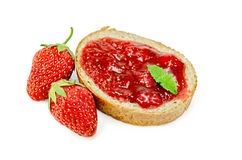Bread with strawberry jam and berries royalty free stock images