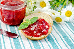 Bread with strawberry jam and knife on a napkin Royalty Free Stock Photography