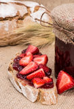 Bread with Strawberry Jam (rustic background) Royalty Free Stock Photos
