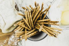 Bread straws on flour and dough. Bread straws on the background of flour and dough stock photography