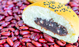 Bread stuffed with red beans. Sprinkle with sesame seeds. on red beans Stock Images