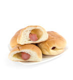 Bread stuffed with Sausage on a white background. Royalty Free Stock Photos