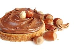 Bread with sweet chocolate hazelnut spread stock photography