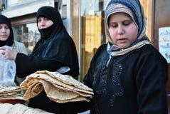 Bread. Syrian women take bread at bakery in Aleppo, Syria Royalty Free Stock Photo