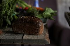 Bread at the table on dark background royalty free stock photography