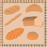 Bread on tablecloth Stock Image
