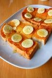 Bread toast with honey and banana Royalty Free Stock Image