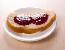 Bread toast with jam on the white dish Stock Photo