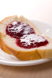 Bread toast with jam on the white dish Stock Image