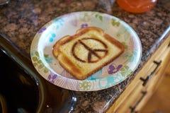 Bread toast with peace symbol. Crunchy bread toast with peace symbol lying on plate Stock Photo