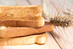 Bread toast on the table with ears of oats Stock Image
