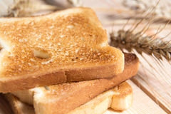 Bread toast on the table with ears of oats Royalty Free Stock Photos