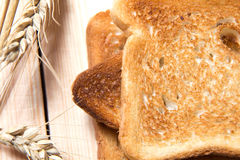 Bread toast on the table with ears of oats Royalty Free Stock Photo