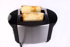 Bread Toast in Toaster Machine Stock Photos