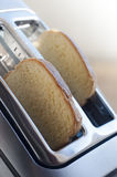 Bread toaster. In the kitchen;Breakfast concept Stock Photo