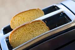 Bread toaster. In the kitchen;Breakfast concept Royalty Free Stock Photography