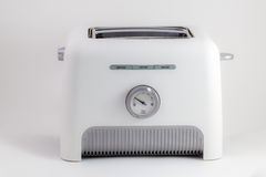 Bread toaster. White bread toaster on white background Royalty Free Stock Images