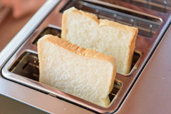 Bread in Toaster. Close up to Bread in Toaster Stock Image