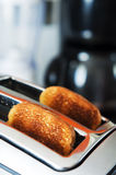 Bread toaster in the kitchen. Breakfast concept Stock Photos