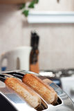Bread toaster in the kitchen morning Royalty Free Stock Images