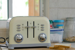 Bread toaster. Modern design of the bread toaster in the kitchen interior Royalty Free Stock Photos