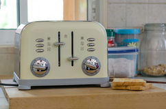 Bread toaster. Modern design of the bread toaster in the kitchen interior Royalty Free Stock Photography