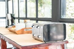 Bread toaster on table. Bread toaster on the table Royalty Free Stock Photos